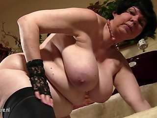Heavy titted granny showing her age-old cunt