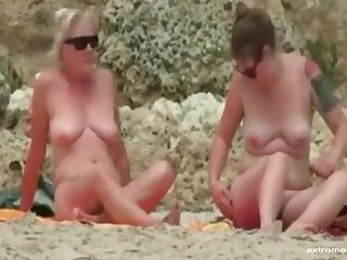 sister During our holiday my blonde wife and my busty friend surprised us by going leafless on the beach.