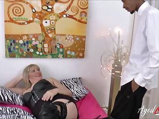 Busty blonde mature gets chubby black cock deep inside her vagina