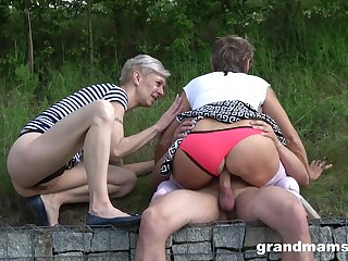 Public amateur making love with two matures and a young cock