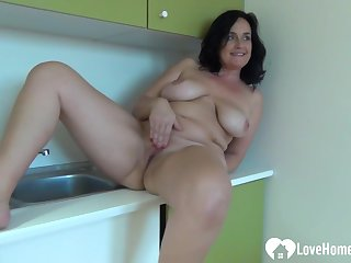 Amateur Porn unshaded with big knockers fingers herself