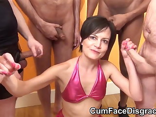 Teensy-weensy mature sucks cocks within reach bukkake party