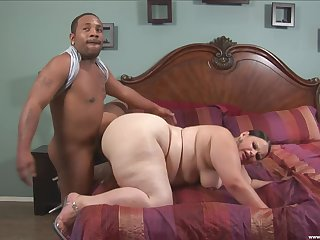 Chubby woman deals black man's huge cock in positive passion