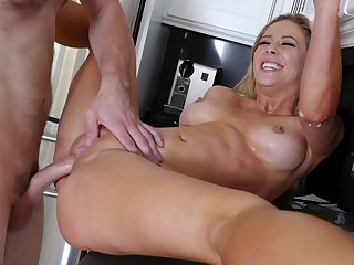 Blonde wife Cherie Deville with the perfect body fucked in the matter of the kitchen