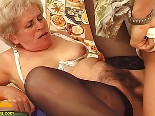 Hairy Hungarian granny is sucking a approvingly younger guys dick increased by getting fucked hard, in return