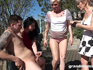 Wild outdoors gangbang with two clothes-horse and three mature sluts